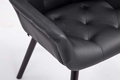 CLP Esszimmerstuhl CASSIDY mit Kunstlederbezug und sesselförmigem gepolstertem Sitz   Retro-Stuhl mit Armlehne und einer Sitzhöhe von 46 cm   Bis zu 150 kg belastbarer Polsterstuhl Schwarz, Holzgestell Farbe coffee